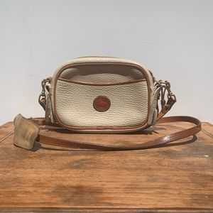 Dooney & Bourke small tan leather crossbody bag